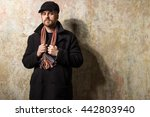 serious bearded man wearing a... | Shutterstock . vector #442803940
