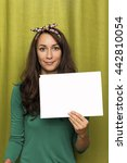 Girl Holding Blank Sheet Of...