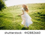 young girl in a white dress in... | Shutterstock . vector #442882660