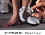 hand proposing capsule to... | Shutterstock . vector #442937110