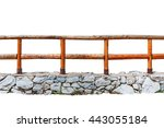 Wooden Fence On A Stone Wall...