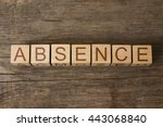 Small photo of the word of ABSENCE on a wooden cubes