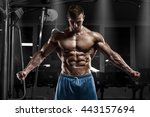 sexy muscular man in gym ... | Shutterstock . vector #443157694
