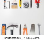 Various tools over a blank panel - stock photo