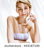 beautiful blonde girl removing... | Shutterstock . vector #443187100