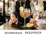 Stock photo expert barman is making cocktail at night club 443195929