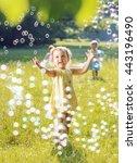 little girl blowing soap... | Shutterstock . vector #443196490