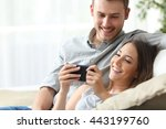 happy couple enjoying media... | Shutterstock . vector #443199760