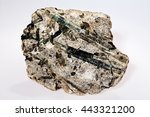 Small photo of actinolite mineral Inosilicates with talc on the white background