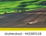 Farm Tractor Handles Earth On...