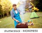 handsome man preparing barbecue ... | Shutterstock . vector #443409850