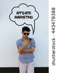 Small photo of Young man holding mobile phone writen Affiliate Marketing on it