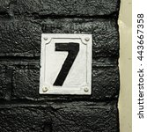 House Number Seven On A Black...