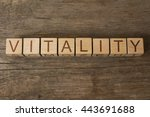 Stock photo vitality word written on a wooden cubes 443691688