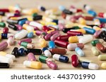 heap of medicine capsules and