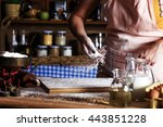female baker sprinkle the flour ... | Shutterstock . vector #443851228