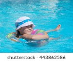 little girl swims in the pool... | Shutterstock . vector #443862586
