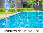 man cleaning the swimming pool | Shutterstock . vector #443923270