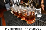 drinks lined up on a bar with... | Shutterstock . vector #443925010
