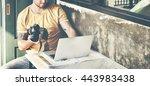man camera photographer laptop... | Shutterstock . vector #443983438