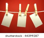 Stock photo blank pieces of paper hang on clothes line 44399287