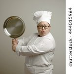 funny asian chef holding iron... | Shutterstock . vector #444015964