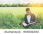 young hipster man sitting on... | Shutterstock . vector #444036343
