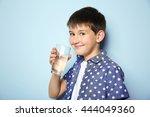 cute boy drinking water on... | Shutterstock . vector #444049360