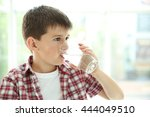 cute boy drinking water on... | Shutterstock . vector #444049510