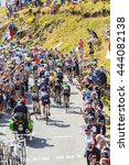 Small photo of COL DU GLANDON, FRANCE - JUL 23: The peloton riding on the road to Col du Glandon during the stage 18 of Le Tour de France on July 23, 2015.