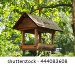 Wooden Feeder In A Tree