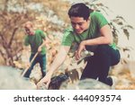 volunteers picking up litter in ... | Shutterstock . vector #444093574