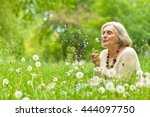senior woman in green park | Shutterstock . vector #444097750