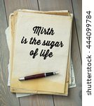 Small photo of Traditional English proverb. Mirth is the sugar of life