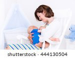young mother holding her... | Shutterstock . vector #444130504