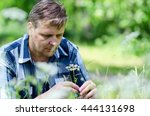 Small photo of Melancholic man ponders serious problem during nature walk