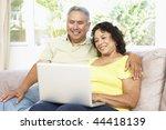 senior couple using laptop at...   Shutterstock . vector #44418139