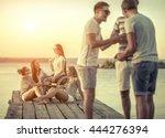 friends sitting on wooden pier... | Shutterstock . vector #444276394