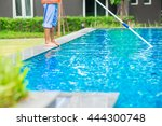 man cleaning the swimming pool | Shutterstock . vector #444300748