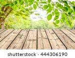 empty wooden table with garden... | Shutterstock . vector #444306190