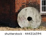 Old Millstone Wheel Outside At...