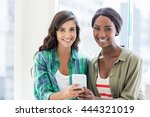 happy friends using mobile phone   Shutterstock . vector #444321019