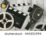 old movie camera with film... | Shutterstock . vector #444351994