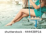 smooth female legs above water | Shutterstock . vector #444438916
