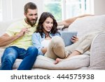 couple sitting on sofa and... | Shutterstock . vector #444575938
