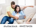 couple sitting on sofa and... | Shutterstock . vector #444576436