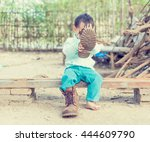 thai baby boy try to  wearing... | Shutterstock . vector #444609790
