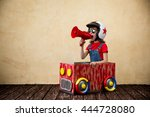 child driving a car made of... | Shutterstock . vector #444728080