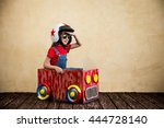 child driving a car made of... | Shutterstock . vector #444728140
