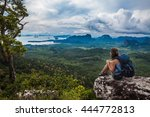 young backpacker sitting on a... | Shutterstock . vector #444772813